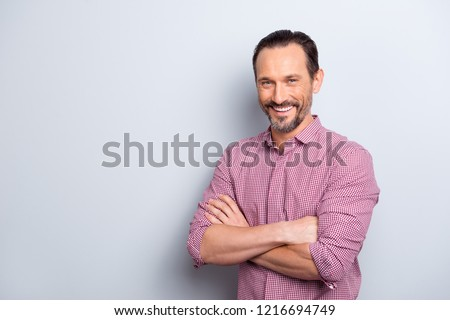 Photo of good-wearing good-looking man stand isolated on light gray background with copy space for text make beaming toothy smile hold hands over chests #1216694749