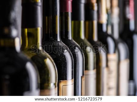 Line of wine bottles. Close-up. #1216723579