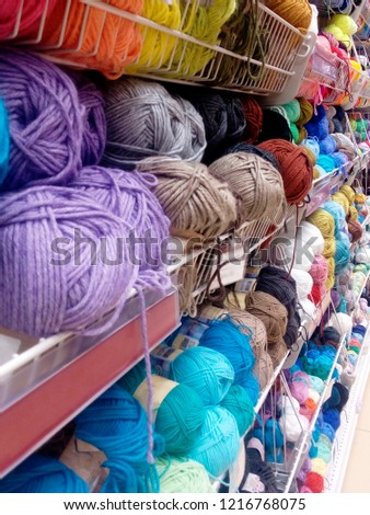 showcase with threads for knitting, needlework #1216768075