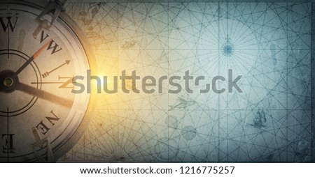 Old sea compass on abstract map background. Pirate and nautical theme grunge background. Retro style. #1216775257