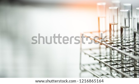 Laboratory glassware containing chemical liquid, science research,science background #1216865164