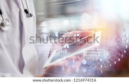 Dctor work on digital tablet healthcare doctor technology tablet using computer #1216974316