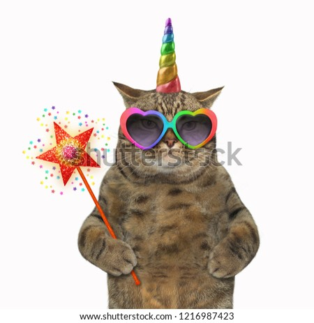 The cat unicorn in glasses is holding a magic wand. White background.