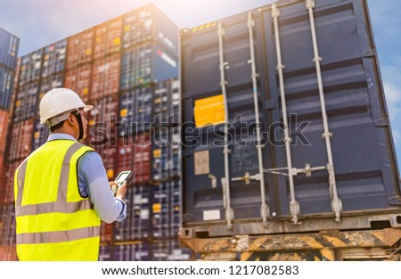 Foreman control loading Containers box to truck for Logistic Import Export Background, Business logistic concept, import and export concept #1217082583