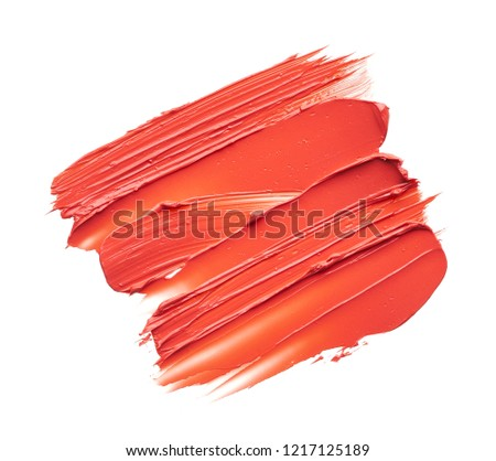 Smear and texture of red lipstick or acrylic paint isolated on white background. #1217125189