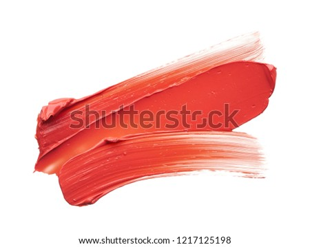 Smear and texture of red lipstick or acrylic paint isolated on white background. #1217125198