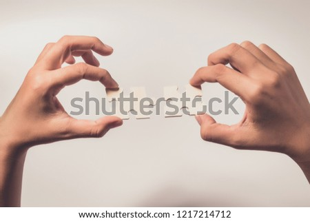 Pieces of jigsaw puzzle in woman's hands #1217214712