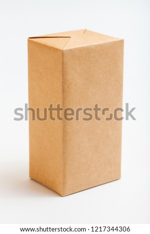 Boxes wrapped in kraft paper. Isolated on white. #1217344306