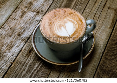 Cappuccino coffee with heart drawing #1217360782