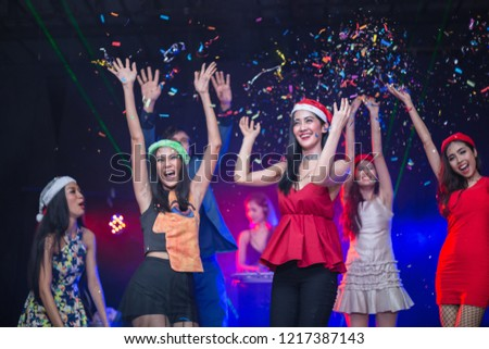 Cheerful smilling happily young people showered with confetti on club party. #1217387143
