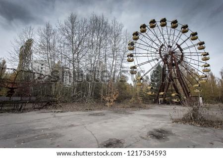 Ferris wheel in the Pripyat of Chernobyl Exclusion Zone. Amusement park in Pripyat. Chernobyl disaster. #1217534593