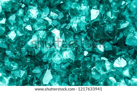 Emerald, Sapphire or Tourmaline green crystals. Gems. Mineral crystals in the natural environment. Stone of precious crystals on white background is insulated. Copy space. Colored shiny bokeh surface. #1217633941