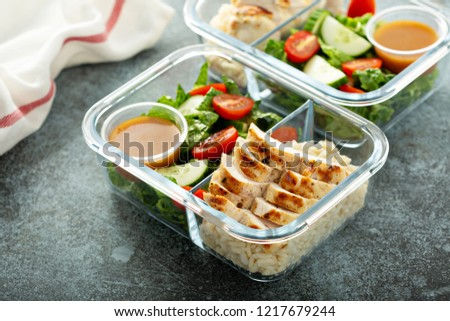 Meal prep lunch box containers with grilled chicken and fresh vegetables #1217679244