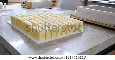 Cut Handmade Soap - Making Handmade Soap Inside the Soap Shop. Cut handmade soap on a table.   #1217710117
