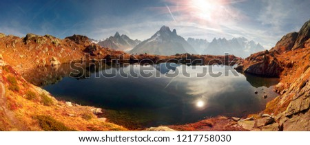 Mont Blanc Chamonix France autumn - picturesque lakes are fantastically beautiful after the first frost against the background of the steep peaks of the Alps with glaciers and rocks #1217758030