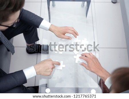 top view.business people collect puzzle #1217765371
