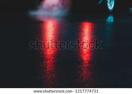 Parking lights on wet pavement at night.  Exhaust Smoke. The smoke from the exhaust pipe with vintage edited. #1217774731