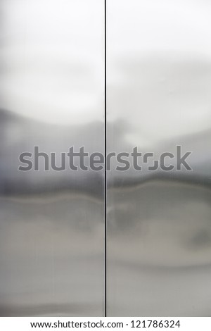 Stainless steel, closed metal door detail, interior