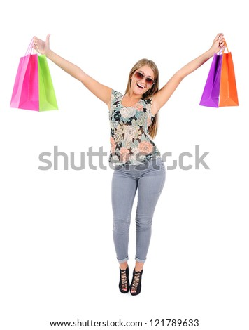 Isolated young casual woman with shopping bag #121789633