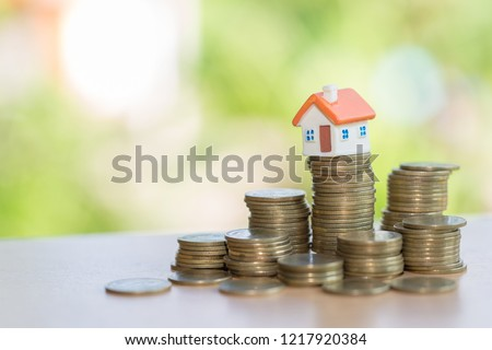 Mini house on stack of coins,Money and house, Real estate investment, Save money with stack coin, Mortgage concept.  #1217920384