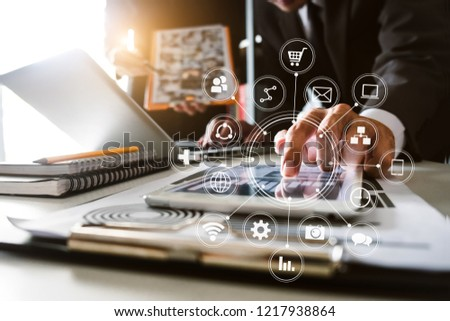Business team present. professional investor working new start up project. .Digital tablet laptop computer Finance managers meeting with digital marketing media  in virtual icon in morning light #1217938864