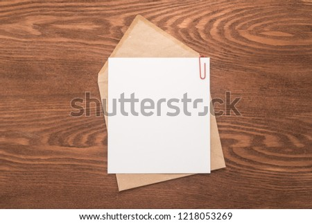 Envelope on a wooden background