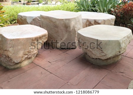 Stone chair in park #1218086779