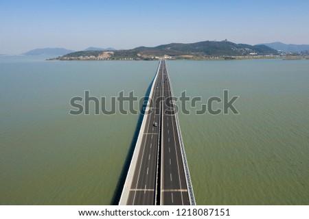 Long 4  lane Bridge over water aerial drone photo #1218087151