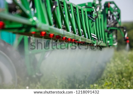 close up green sprayer to protect plants while working in the field #1218091432