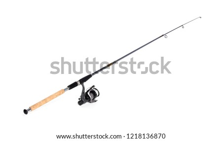 Modern fishing rod with reel on white background #1218136870
