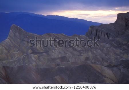 Zabriskie Point in an unusual blue light at dusk, Death Valley National Park, California, USA. #1218408376