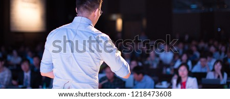 Speaker at Talk in Business Conference. Tech Executive Entrepreneur Speaker on Stage at Conference. Presenter Giving Business Presentation at Meeting. Corporate Exhibition for Investors Event.  Royalty-Free Stock Photo #1218473608