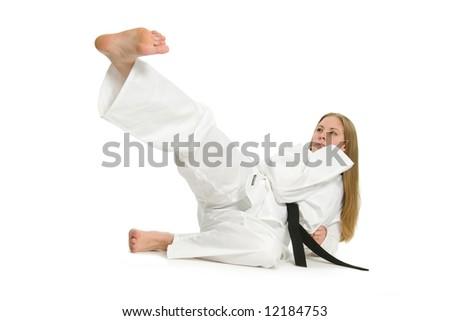 Black belt female martial artist doing kick on the ground. #12184753
