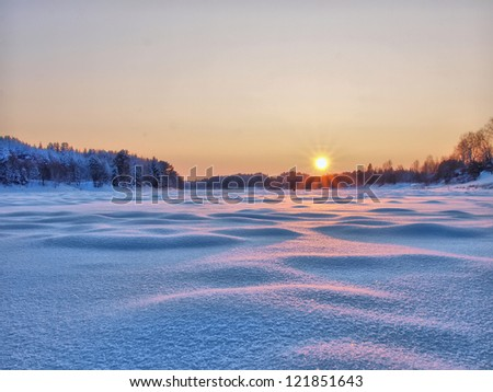 Sunset in winter. Winter rural landscape with the river at sunset. #121851643