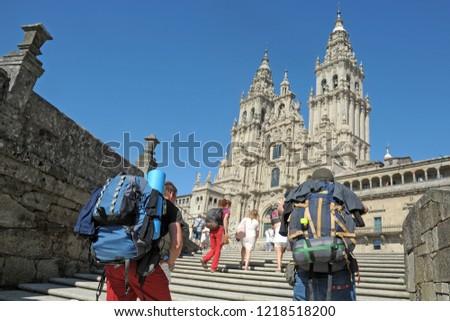 Way of St James , Camino de Santiago ,  pilgrims arrive  to Compostela Cathedral ,Galicia, Spain  #1218518200