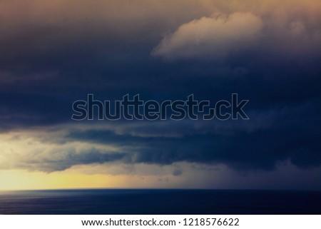 black sky before the rain on the sea #1218576622