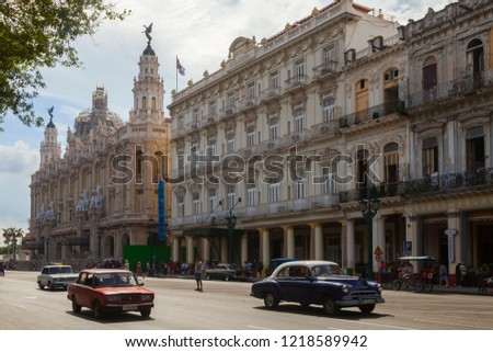 Havana, Havana, Cuba. 11-05-2015 Avenue in Havana with old cars.In the background is the Hotel Inglaterra, and the grand theater with its characteristic dome with the bronze angel.Viejos automóviles,  #1218589942