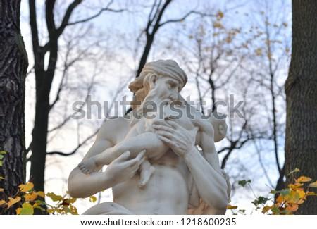 The God Saturn statue in Summer Garden at autumn evening, St.Petersburg, Russia.