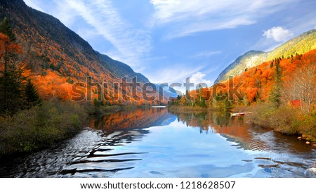Autumn landscape in Parc de la national  Jacques Cartier #1218628507