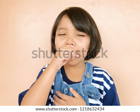 Sick asian little child girl cough from common cold. #1218632434
