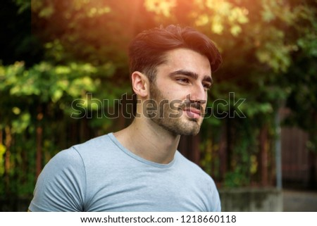 Handsome young man outdoor looking away to a side #1218660118