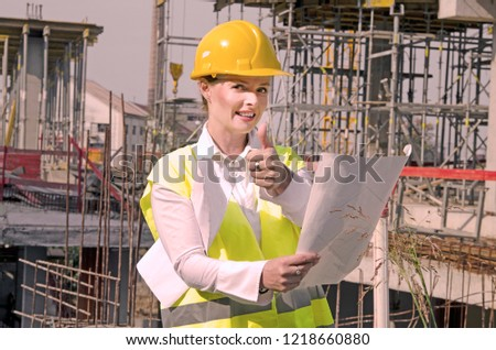 Female engineer in safety uniform and helmet in reconstruction area showing thumbs up. Good progress in construction site #1218660880