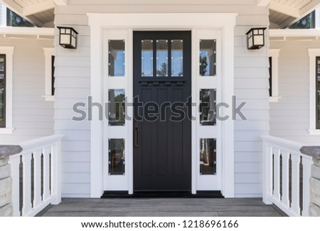 Front black door that is secured Royalty-Free Stock Photo #1218696166
