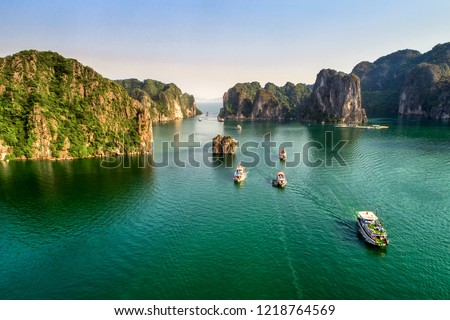 Aerial view floating fishing village and rock island, Halong Bay, Vietnam, Southeast Asia. UNESCO World Heritage Site. Junk boat cruise to Ha Long Bay. Popular landmark, famous destination of Vietnam #1218764569