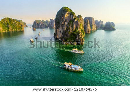 Aerial view floating fishing village and rock island, Halong Bay, Vietnam, Southeast Asia. UNESCO World Heritage Site. Junk boat cruise to Ha Long Bay. Popular landmark, famous destination of Vietnam Royalty-Free Stock Photo #1218764575