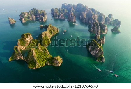 Aerial view floating fishing village and rock island, Halong Bay, Vietnam, Southeast Asia. UNESCO World Heritage Site. Junk boat cruise to Ha Long Bay. Popular landmark, famous destination of Vietnam #1218764578