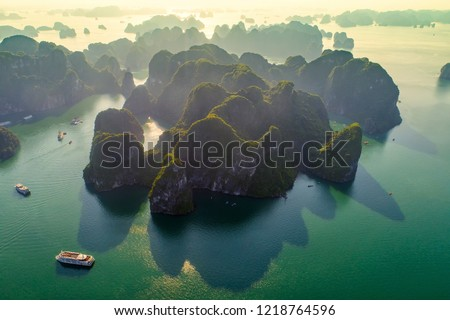 Aerial view floating fishing village and rock island, Halong Bay, Vietnam, Southeast Asia. UNESCO World Heritage Site. Junk boat cruise to Ha Long Bay. Popular landmark, famous destination of Vietnam #1218764596