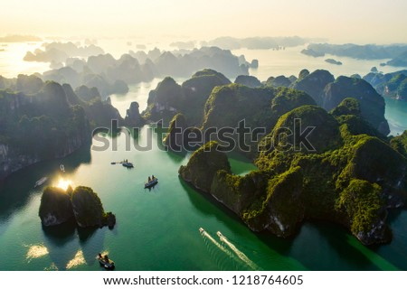Aerial view floating fishing village and rock island, Halong Bay, Vietnam, Southeast Asia. UNESCO World Heritage Site. Junk boat cruise to Ha Long Bay. Popular landmark, famous destination of Vietnam #1218764605