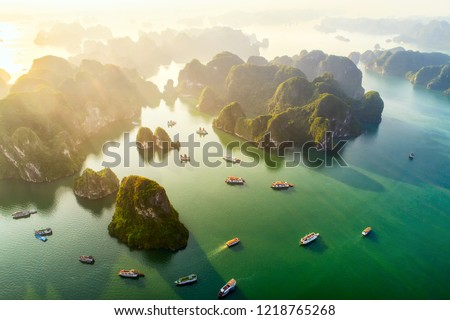 Aerial view floating fishing village and rock island, Halong Bay, Vietnam, Southeast Asia. UNESCO World Heritage Site. Junk boat cruise to Ha Long Bay. Popular landmark, famous destination of Vietnam  Royalty-Free Stock Photo #1218765268