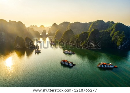Aerial view floating fishing village and rock island, Halong Bay, Vietnam, Southeast Asia. UNESCO World Heritage Site. Junk boat cruise to Ha Long Bay. Popular landmark, famous destination of Vietnam  #1218765277